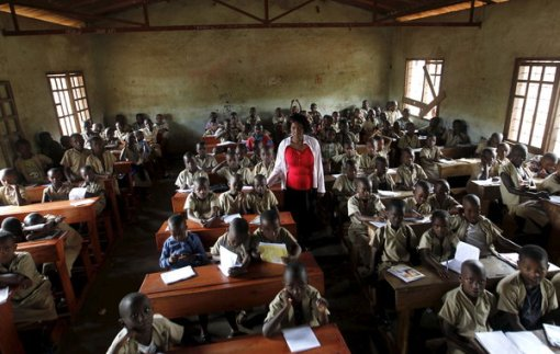 30 Sep 2015, Bujumbura, Burundi --- A teacher leads a class session at the ecole primaire Ave Marie in Burundi's capital Bujumbura, April 24, 2015. Nearly three years after Taliban gunmen shot Pakistani schoolgirl Malala Yousafzai, the teenage activist last week urged world leaders gathered in New York to help millions more children go to school. World Teachers' Day falls on 5 October, a Unesco initiative highlighting the work of educators struggling to teach children amid intimidation in Pakistan, conflict in Syria or poverty in Vietnam. Even so, there have been some improvements: the number of children not attending primary school has plummeted to an estimated 57 million worldwide in 2015, the U.N. says, down from 100 million 15 years ago. Reuters photographers have documented learning around the world, from well-resourced schools to pupils crammed into corridors in the Philippines, on boats in B --- Image by © THOMAS MUKOYA/Reuters/Corbis